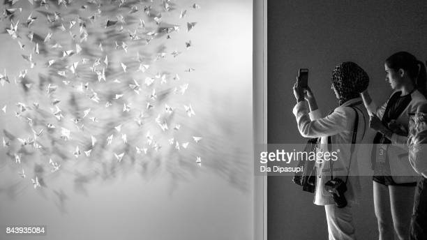 Guests take pictures before the Noon By Noor fashion show at New York Fashion Week The Shows at Gallery 3 Skylight Clarkson Sq on September 7 2017 in...