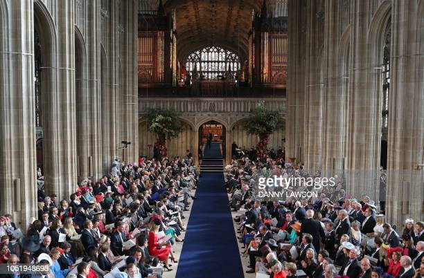 Guests take thier seats inside St George's Chapel ahead of the wedding of Britain's Princess Eugenie of York to Jack Brooksbank at Windsor Castle in...