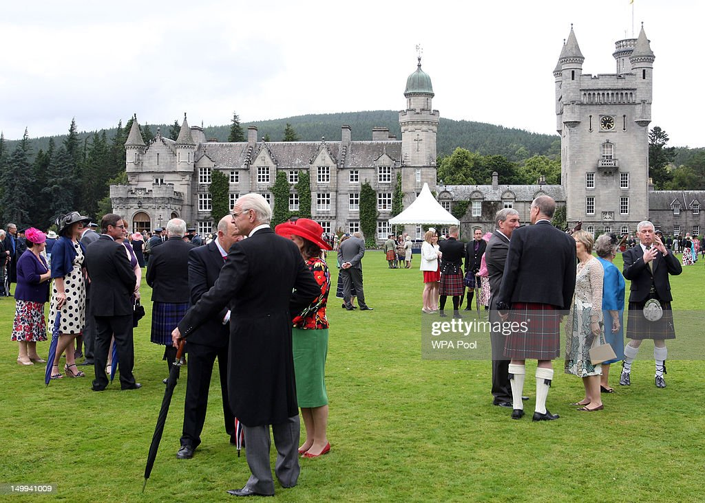 Guests talk as Queen Elizabeth II (not pictured) hosts a Garden Party at Balmoral Castle, on August 07, 2012 in Aberdeenshire, Scotland.