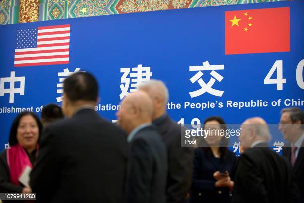Guests talk before an event commemorating the 40th anniversary of the establishment of diplomatic relations between the United States and China at...