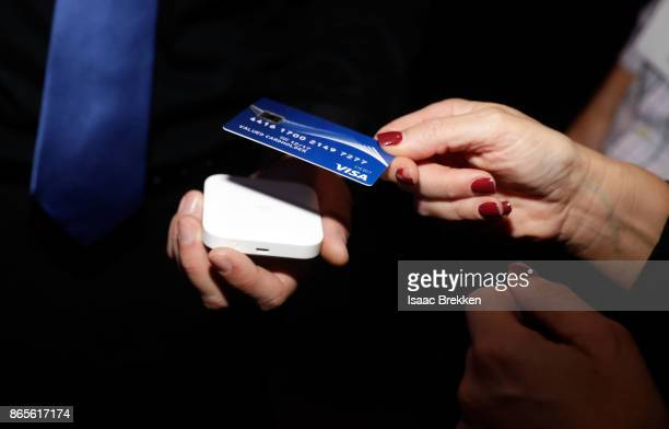 Guests tap to pay using contactless cards to support releif efforts during the Visa ID Intelligence launch party at Money 20/20 on October 23 2017 in...