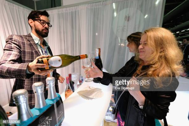 Guests taste Poggio wines at the Food Network Cooking Channel New York City Wine Food Festival presented by CocaCola Grand Tasting presented by...