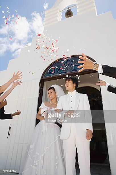 guests throwing confetti over newlyweds - church wedding decorations stock pictures, royalty-free photos & images