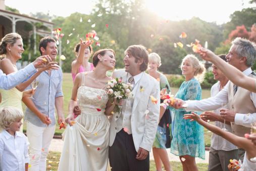 Guests throwing rose petals on bride and groom - gettyimageskorea