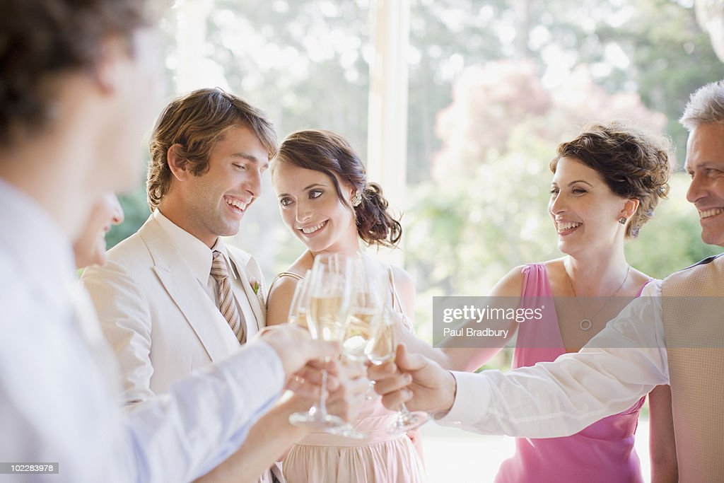 Guests toasting with champagne at wedding reception : Stock Photo