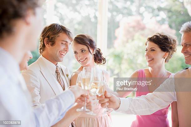 guests toasting with champagne at wedding reception - guest stock pictures, royalty-free photos & images
