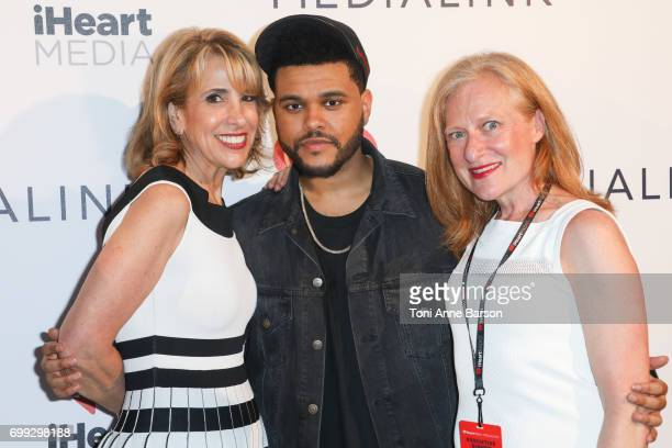 Guests Tom Poleman and The Weeknd pose after The Weeknd performed at a VIP dinner party hosted by iHeartMedia and MediaLink at Hotel du CapEdenRock...