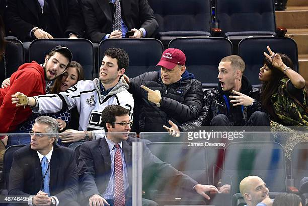 Guests Truman Hanks Tom Hanks Chet Hanks and guest attend the Los Angeles Kings vs New York Rangers game at Madison Square Garden on March 24 2015 in...