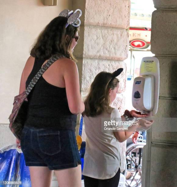 Guests use a hand sanitzing station at the Magic Kingdom at Walt Disney World in Lake Buena Vista Fla Thursday March 12 2020