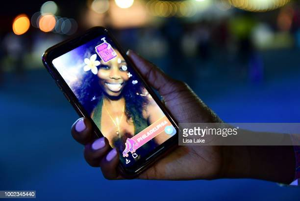 Guests use a Snapchat filter during HBO's Mixtapes Roller Skates at the Blue Cross RiverRink in Philadelphia Pennsylvania on July 19 2018 in...