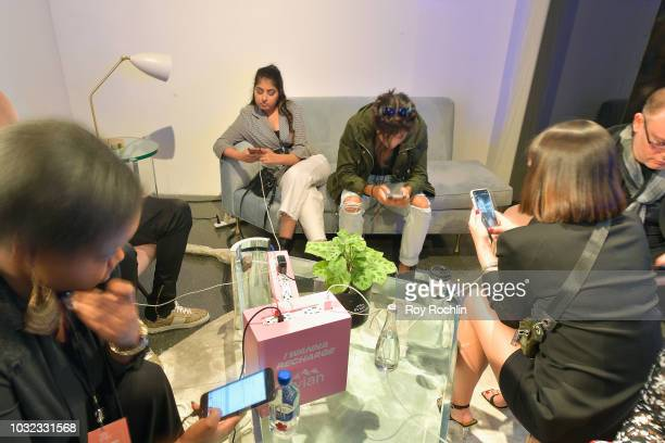 Guests use an Evian recharging station at the Visa lounge at New York Fashion Week The Shows at Spring Studios on September 12 2018 in New York City