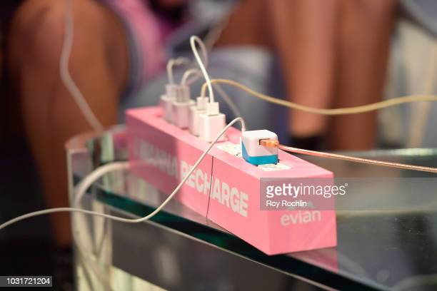Guests use an Evian recharging station at the Visa lounge during New York Fashion Week The Shows at Spring Studios on September 11 2018 in New York...