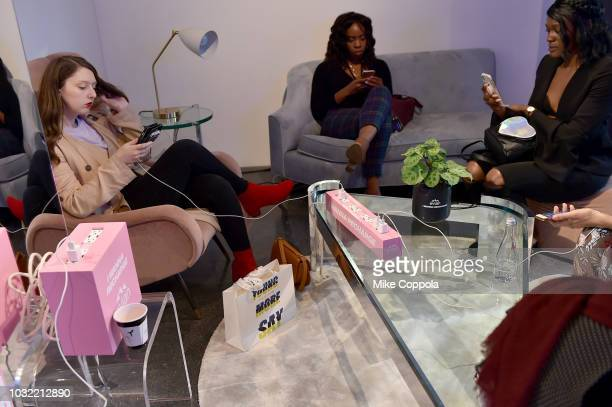Guests use an Evian recharging station whlie relaxing at the Visa lounge at New York Fashion Week The Shows at Spring Studios on September 12 2018 in...