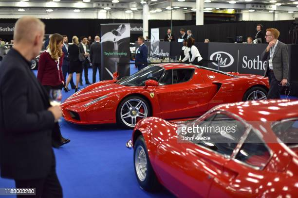 Guests view a 2003 Ferrari Enzo £1000 £1000 on display during the RM Sotherb's London European car collectors event at Olympia London on October 23...