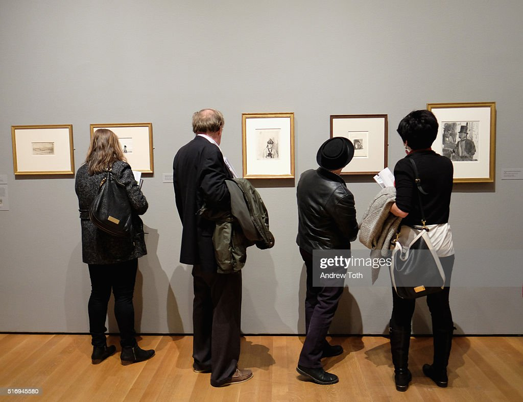 Guests view artwork by Edgar Degas on display during the 'Edgar Degas: A Strange New Beauty' exhibition press preview at Museum of Modern Art on March 22, 2016 in New York City. Ê