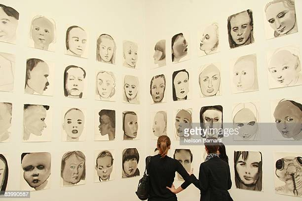 Guests view artwork by Marlene Dumas at the opening of two exhibitions Marlene Dumas Measuring Your Own Grave and Artist's Choice Vik Muniz Rebus at...