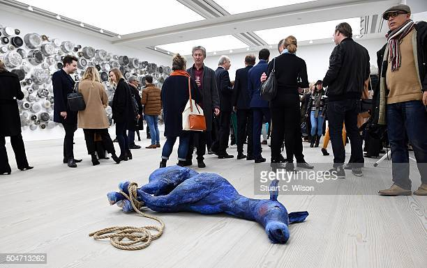 Guests view artworks at Saatchi's first ever all female show to mark the Gallery's 30th Anniversary at the Saatchi Gallery on January 12 2016 in...
