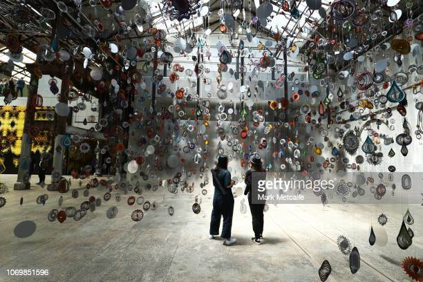 Guests view artworks during the Australian premiere of Nick Cave's solo exhibition 'Until' at Carriageworks on November 20, 2018 in Sydney, Australia.