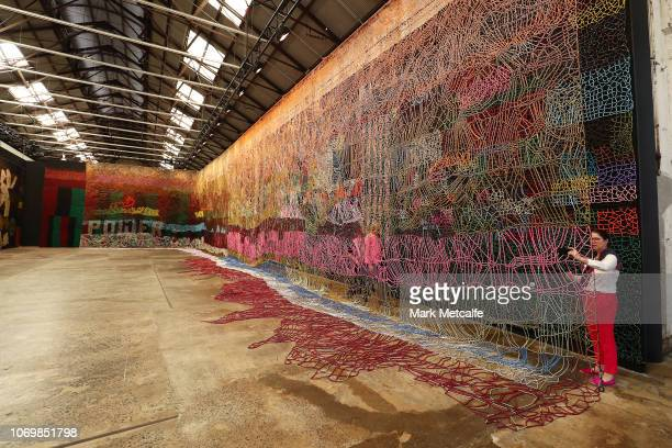 Guests view artworks during the Australian premiere of Nick Cave's solo exhibition 'Until' at Carriageworks on November 20 2018 in Sydney Australia