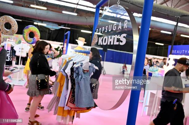 Guests view clothes at the Kohls booth during the POPSUGAR Play/ground at Pier 94 on June 22 2019 in New York City