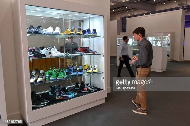 Guests view sneakers on display for The Ultimate Sneaker Collection online auction at Sotheby's on July 15 2019 in New York City