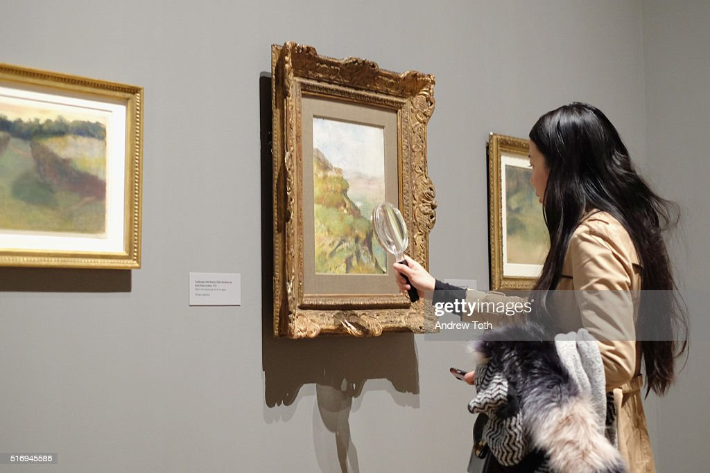 A guests views artwork by Edgar Degas on display during the 'Edgar Degas: A Strange New Beauty' exhibition press preview at Museum of Modern Art on March 22, 2016 in New York City. Ê