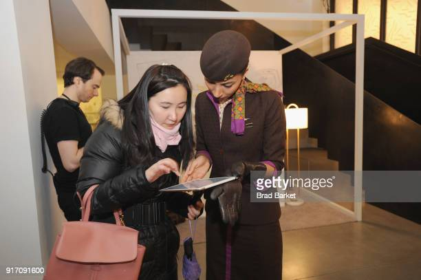 Guests visit the Etihad Atelier for a monogrammed luggage tag by Etihad Airways during IMG NYFW The Shows at Spring Studios on February 11 2018 in...