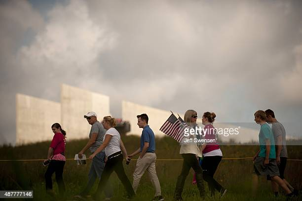 Guests visit the Flight 93 National Memorial during the 14th anniversary of the 9/11 attack in Shanksville Pennsylvania Homeland Security Secretary...