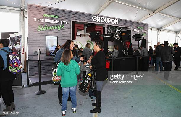 Guests visit the Groupon station during Jets Chefs The Ultimate Tailgate hosted by Joe Namath and Mario Batali Food Network Cooking Channel New York...