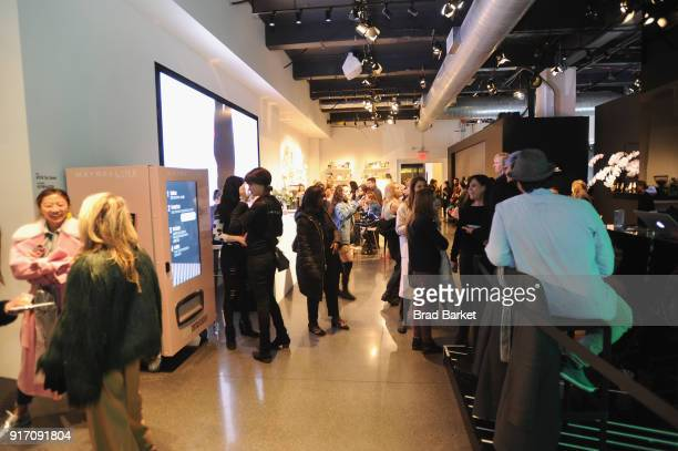 Guests visit the Maybelline vending machine during IMG NYFW The Shows at Spring Studios on February 11 2018 in New York City