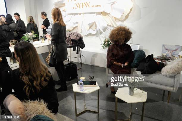 Guests visit the Papyrus Café during IMG NYFW The Shows at Spring Studios on February 11 2018 in New York City