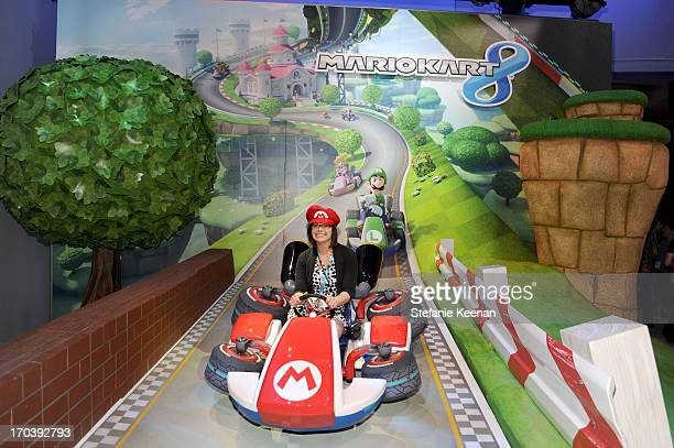 Guests visit the world of Mario Kart 8 available for Wii U in December while attending Nintendo's booth at the 2013 E3 Gaming Convention at Los...
