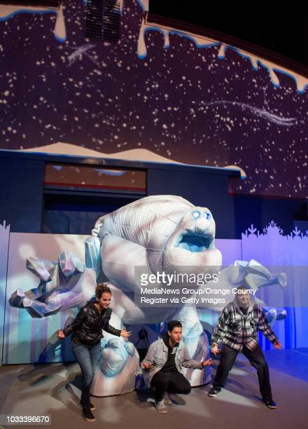Guests visiting Disney California Adventure's new Frozen attraction are photographed with a giant puppet of Frozen character Marshmallow INFORMATION...