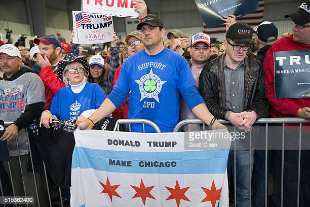 Guests wait for the arrival of Republican presidential candidate Donald Trump at a rally at the Central Illinois Regional Airport on March 13, 2016...