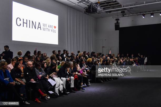 "Guests wait for the start of the ""China, We are With You"" fashion show from Chinese designer Han Wen, who is based in New York, kicking off the..."