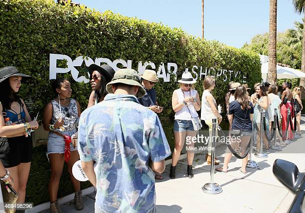 Guests wait in line at POPSUGAR SHOPSTYLE'S Cabana Club Pool Parties Day 2 at the Avalon Hotel on April 12 2015 in Palm Springs California