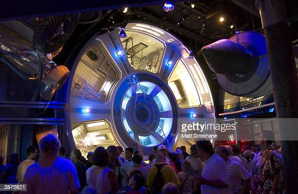 Guests wait in the line for 'Mission Space' at Walt Disney World's Epcot October 8 2003 near Orlando Florida