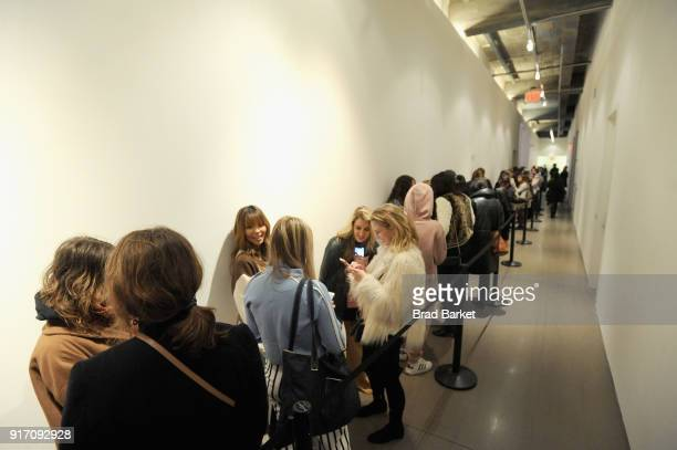 Guests wait outside of a Gallery during IMG NYFW The Shows at Spring Studios on February 11 2018 in New York City