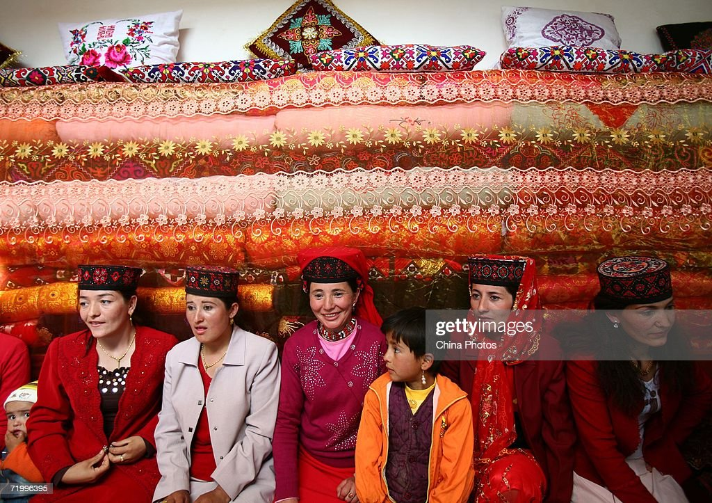 Guests Wait To Have Feast During A Wedding Ceremony Of Tajik Ethnic Minority Group On September