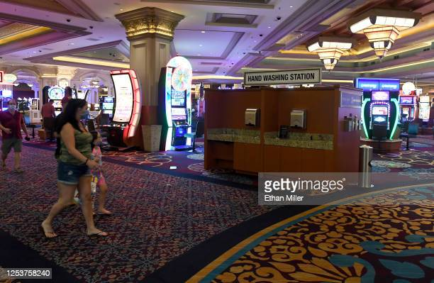 Guests walk by a new handwashing station on the gaming floor at Mandalay Bay Resort and Casino after the Las Vegas Strip property opened for the...