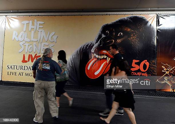 Guests walk by a poster at the MGM Grand Hotel/Casino advertises the May 11 stop of the 50 and Counting tour by the Rolling Stones at the MGM Grand...