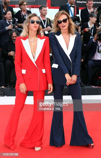 Guests walk the red carpet ahead of the opening ceremony and the 'First Man' screening during the 75th Venice Film Festival at Sala Grande on August...