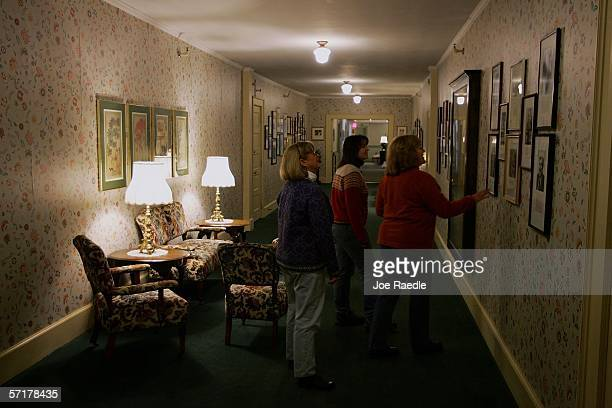 Guests walk through a hallway in the Balsams Grand Resort Hotel originally opened as the Dix House just after the Civil War but bought and renamed by...
