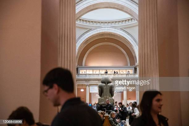 Guests walk through the Metropolitan Museum of Art on March 10 2020 in New York City on March 12 2020 in New York City The museum announced it will...