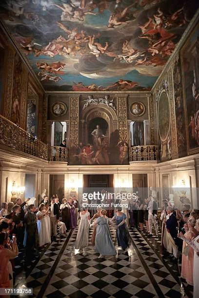 Guests watch a display of regency dancing during the Pride and Prejudice Ball in the painted hall of Chatsworth House on June 22 2013 in Chatsworth...