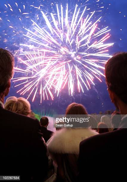 Guests watch a fireworks display during the Mariinsky Ball of Montblanc White Nights Festival at Catherine Palace on June 19 2010 in Pushkin near...