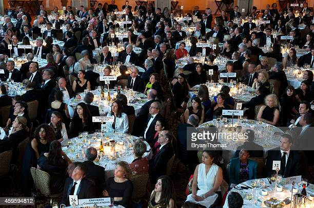 Guests watch a presentation at the Committee to Protect Journalists International Press Freedom Awards at the Waldorf Astoria on November 25 2014 in...