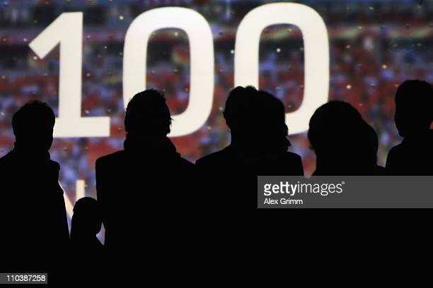 Guests watch a screen during the presentation of the German FIFA Women's World Cup 2011 kit 100 nights before the start of the World Cup at the...