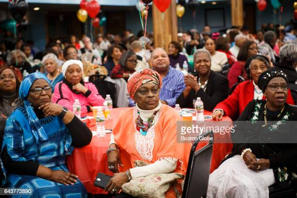 Guests watch as Boston Mayor Marty Walsh makes his remarks during the 4th annual Black History Month Senior Celebration at Prince Hall in Boston on...