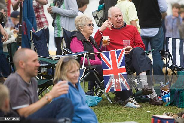Guests watch perfomers at a party to celebrate the royal wedding at a Tea in the Park event in Kate Middleton's home village of Bucklebury Berkshire...